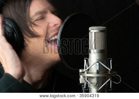 Man Records Vocals In Studio