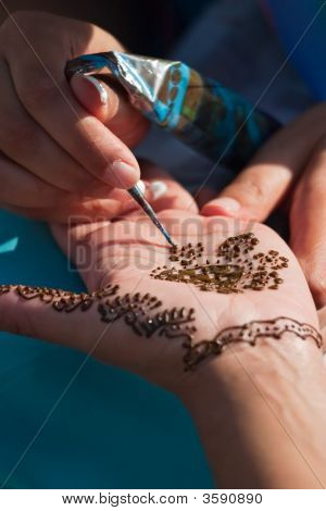 Henna Pattern Painted On Woman'S Hand