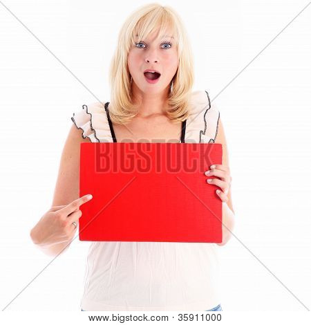 Amazed Woman Pointing To A Blank Red Board