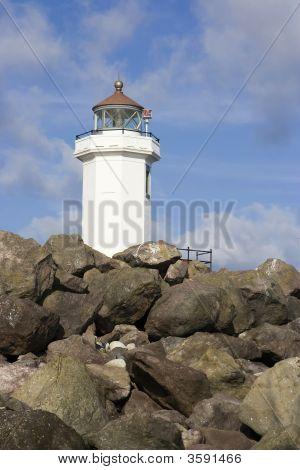 Lighthouse Peaks Above Rocks