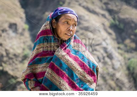 Portrait Of Tibetan Woman In Himalaya Mountains