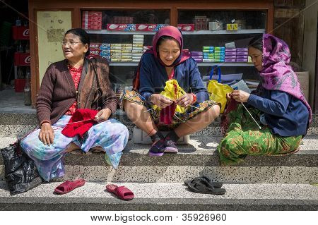 Three Nepalese Women In The Traditional Clothes