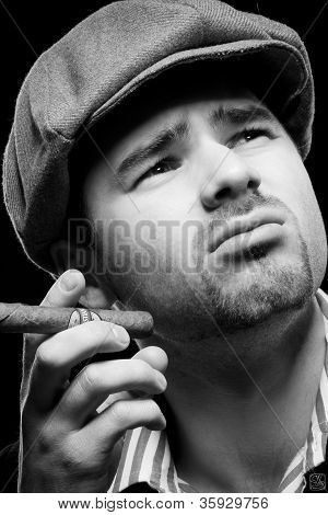 The Black-and-white Emotional Portrait Of The Guy Which Inhales Aroma Of A Cigar