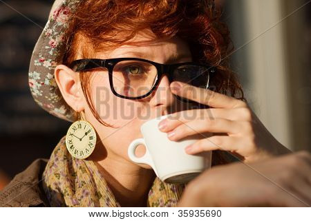Hipster Girl Drinking Coffe At Sunset