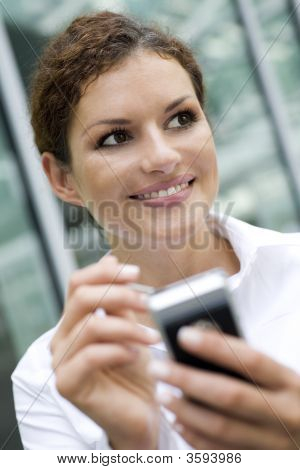 Businesswoman Using Palmtop