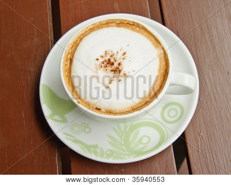 Top View Of Coffee Cup On Wooden Background