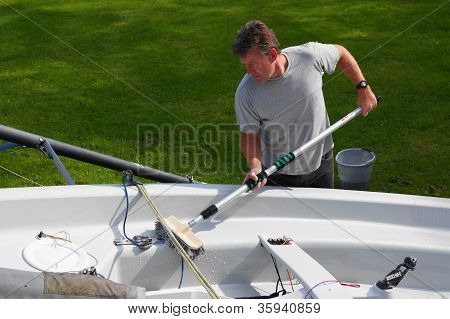 Man Cleaning His Boat