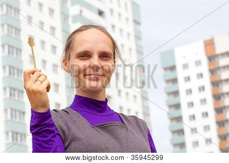 Girl with key from new apartment