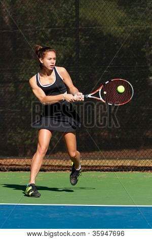 Female Tennis Player Hits Powerful Backhand