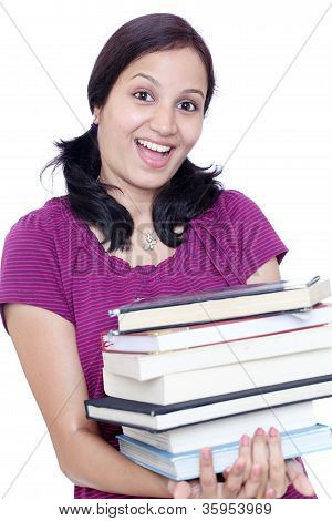 Young Female Student Holding Stack Of Books