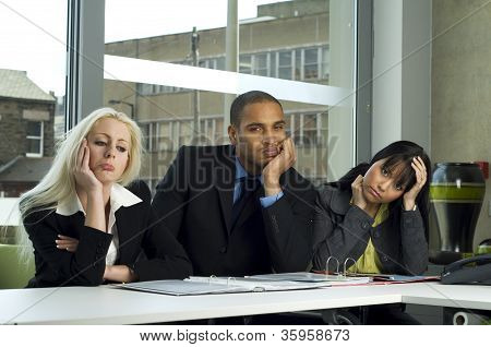 Bored Colleagues In A Meeting
