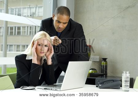 Boss Lecturing Employee As She Works