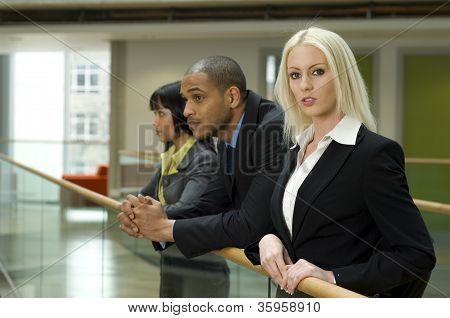 Blonde Business Woman And Two Co-workers