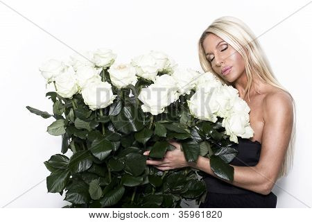 Portrait Of Fresh And Beautiful Woman With Rose