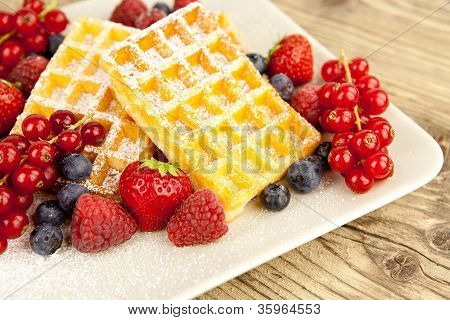 Fresh Tasty Waffer With Powder Sugar And Mixed Fruits