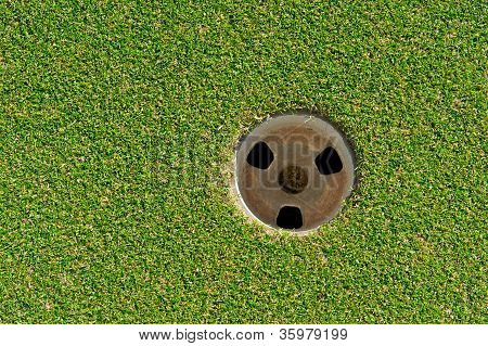 Closeup Of Golf Cup Or Hole