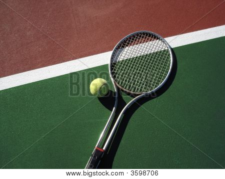 Racquet And Ball On Court