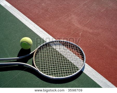 Tennis Racquet And Ball On Court