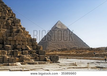 Part of the masonry of the pyramid of Cheops Pyramid of Khafre in the background.