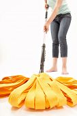 image of cleaning service  - The person cleans a floor a mop on a white background - JPG