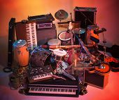 stock photo of transverse  - studio photography with lots of colorful illuminated music instruments mixed into each other - JPG