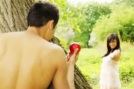 image of adam eve  - Adam holds out an apple to Eve - JPG