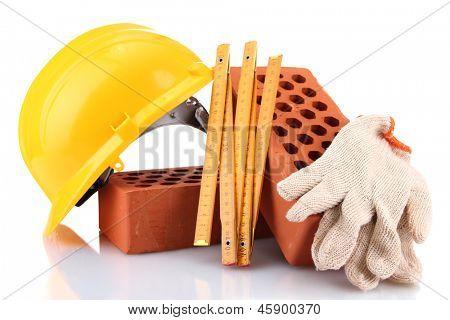 helmet, roulette, bricks and gloves isolated on white