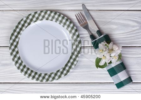 cutlery decorated with flowers of apple on a table