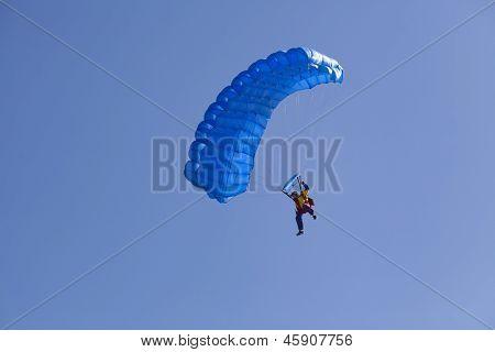 Parachute Flyier On Clear Blue Sky