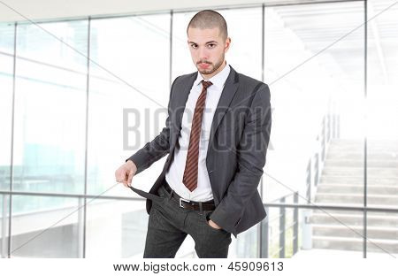 business man showing his empty pocket at the office