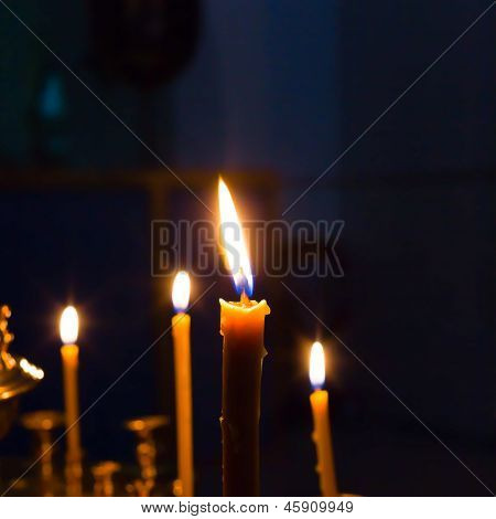 candles lighting in russian orthodox church