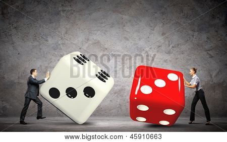 Man and woman pulling dices. Interaction concept