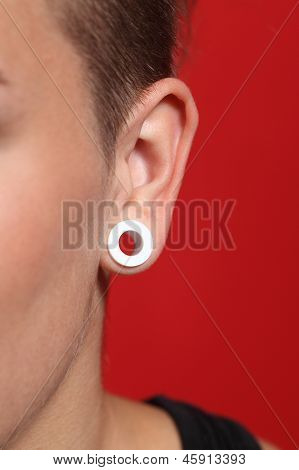 Close Up Of A Woman Ear With An Ear Plug