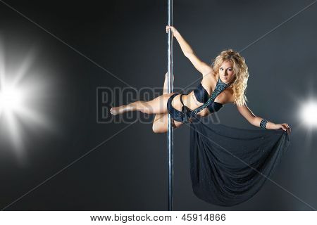 Young sexy woman exercise pole dance