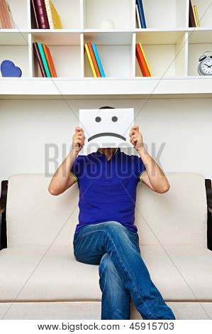 unhappy man sitting on sofa
