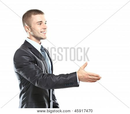 Business man saying welcome by giving the hand for shake