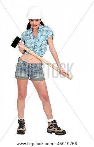 Woman holding sledge-hammer