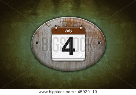 Old Wooden Calendar With July 4.