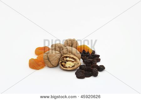 Walnuts, dried apricots and raisins on a white background
