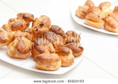 delisious profiteroles on the white plate