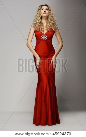 Sophistication. Seductive Woman In Red Fashion Dress. Charisma