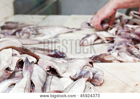 Preparation Of Raw Fish At A Fish Shop