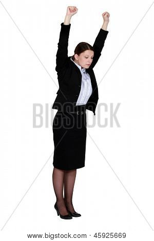 Businesswoman stretching at work