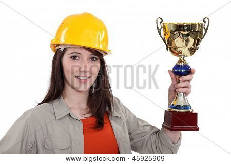 craftswoman holding trophy
