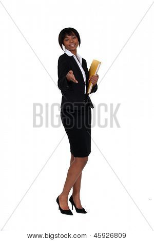 Friendly businesswoman holding her hand out for a handshake