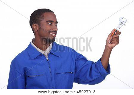 tradesman holding spanner,