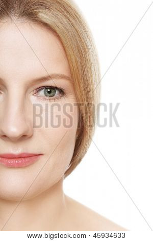 Close-up portrait of beautiful smiling happy mature woman with clear skin, over white background