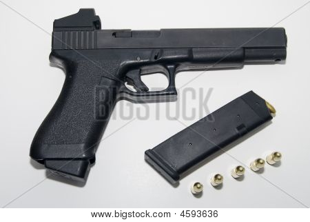 Glock With Magazine And Ammo