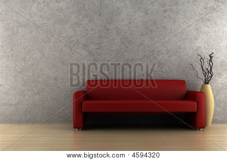 Red Sofa And Vase With Dry Wood In Front Of Gray Wall