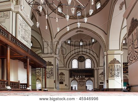 BURSA, TURKEY - AUGUST 20: People in the Ulu Camii (Grand mosque) in Bursa, Turkey on August 20, 2011. Built in the Seljuk style between 1396 and 1399, the mosque has 20 domes and 2 minarets